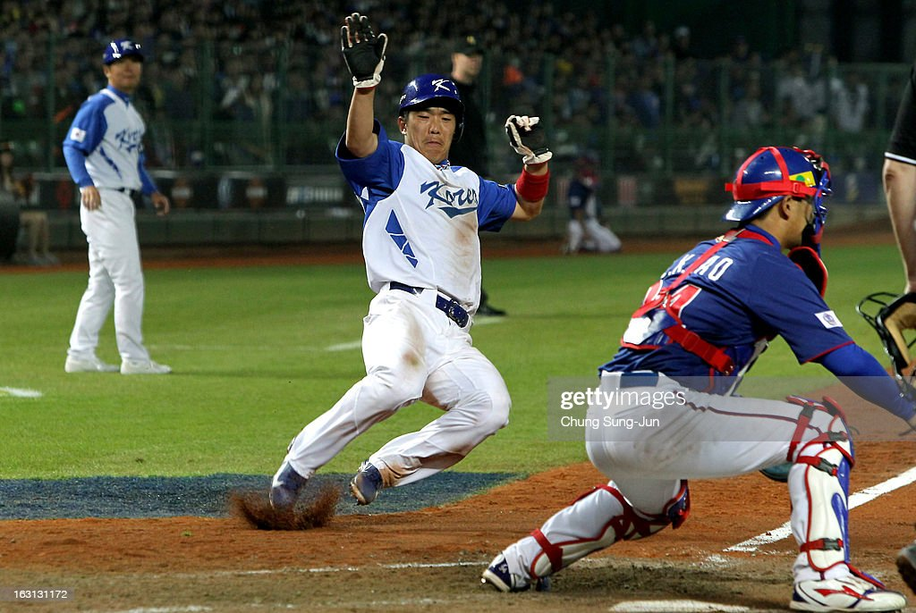 Jeong Keun-Woo of South Korea slides into home base in the fifth inning during the World Baseball Classic First Round Group B match between Chinese Taipei and South Korea at Intercontinental Baseball Stadium on March 5, 2013 in Taichung, Taiwan.