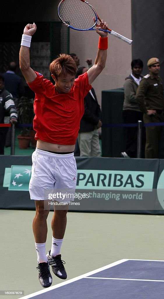 Jeong Suk Young of Korea celebrates after winning Davis cup reverse single match against VM Ranjeeth of India at Delhi Lawn Tennis Association stadium on February 3, 2013 in New Delhi, India.