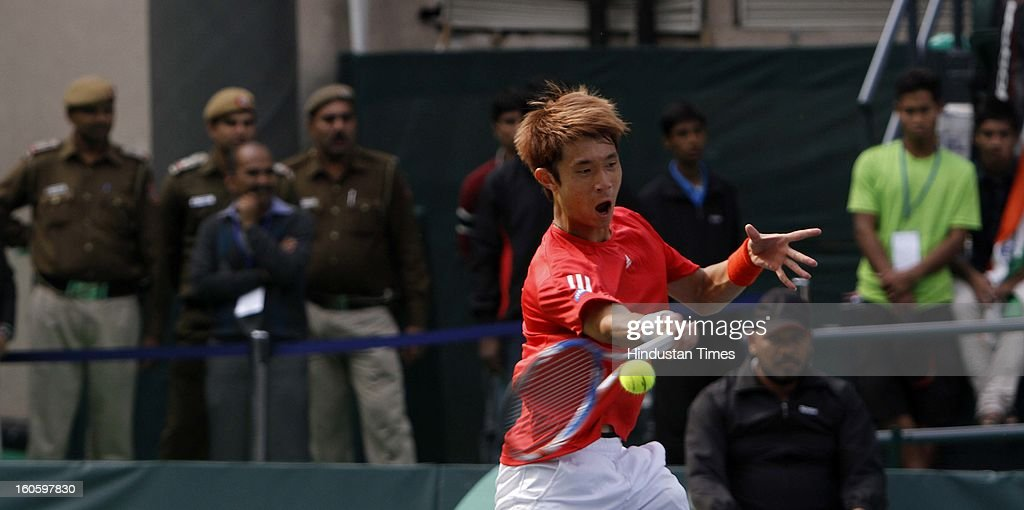 Jeong Suk Young of Korea during Davis cup reverse single match against VM Ranjeeth of India at Delhi Lawn Tennis Association stadium on February 3, 2013 in New Delhi, India.