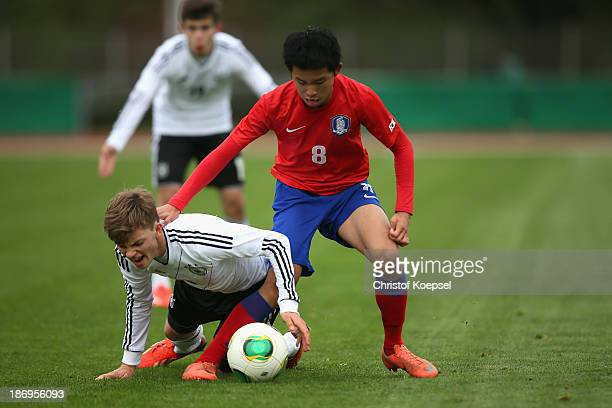 Jeong Wooyeong of South Korea challenges Manuel Wintzheimer of Germany during the U15 international friendly match between Germany and South Korea at...