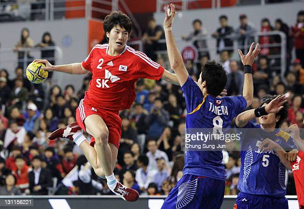 Jeong YiKyeong of South Korea throws a goal during the London Olympic Men's Handball Asian Qualifier Final match between Japan and South Korea at the...