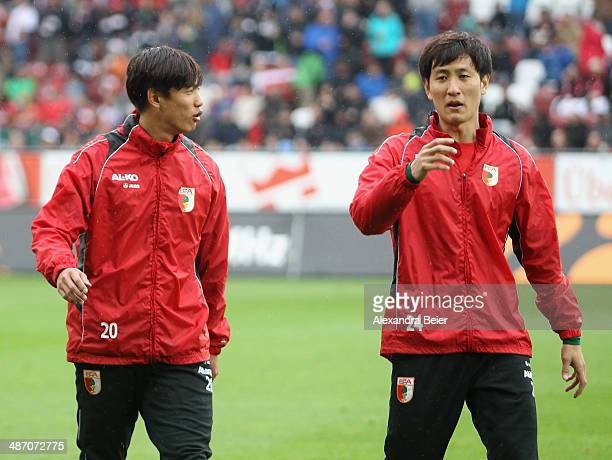 JeongHo Hong and Dong Won Ji of Augsburg chat before during the Bundesliga match between FC Augsburg and Hamburger SV at SGL Arena on April 27 2014...