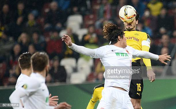 JeongHo Hong of Augsburg and Mats Hummels of Dortmund vie for the ball during the round of sixteen German Cup match between FC Augsburg and Borussia...