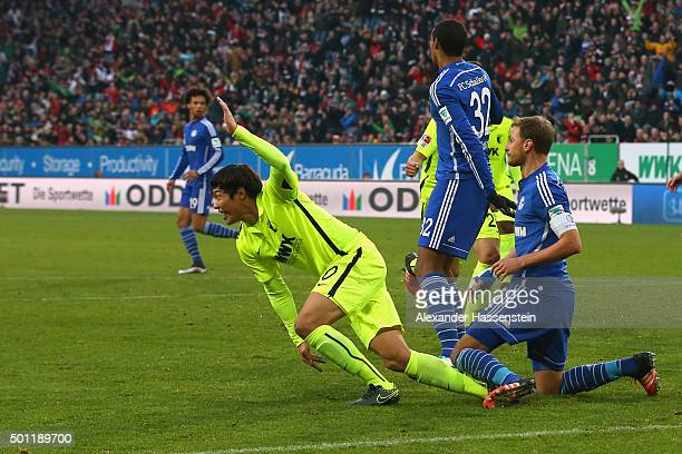 JeongHo Hong of Augsburg celebrates scoring the opening goal during the Bundesliga match between FC Augsburg and FC Schalke 04 at WWK Arena on...