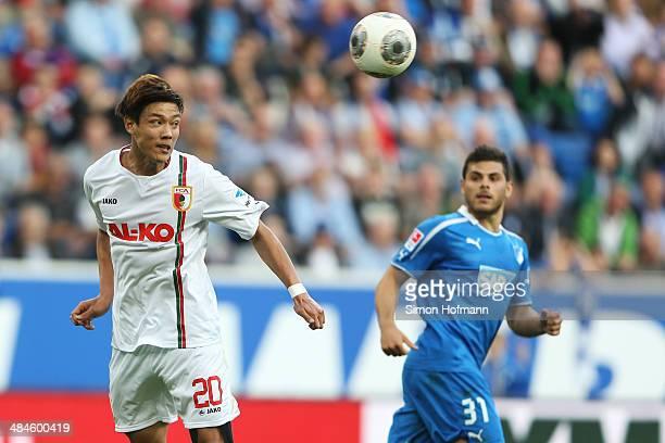 JeongHo Hong of Augsburg jumps for a header during the Bundesliga match between 1899 Hoffenheim and FC Augsburg at Wirsol RheinNeckar Arena on April...