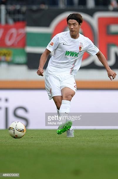 JeongHo Hong of Augsburg kicks the ball during the Bundesliga match between FC Augsburg and Hannover 96 at WWK Arena on September 20 2015 in Augsburg...