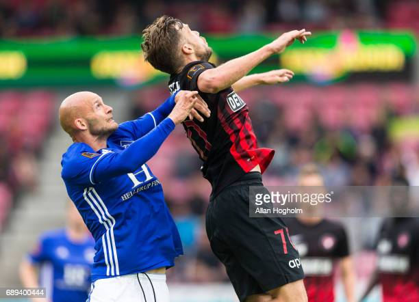Jeppe Brandrup of Lyngby Boldklub and Filip Novak of FC Midtjylland compete for the ball during the Danish Alka Superliga match between FC...