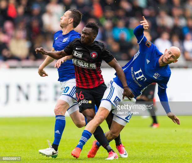 Jeppe Brandrup of Lyngby Boldklub and Rilwan Hassan of FC Midtjylland compete for the ball during the Danish Alka Superliga match between FC...
