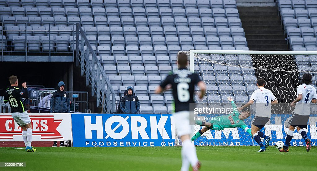Jeppe Curth of Viborg FF scores the 2-0 goal against Goalkeeper Steffen Rasmussen of AGF Aarhus during the Danish Alka Superliga match between AGF Aarhus and Viborg FF at Ceres Park on April 29, 2016 in Aarhus, Denmark.