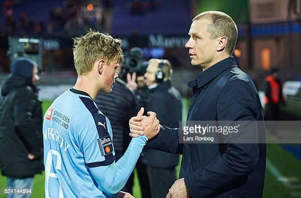 Jeppe Tverskov of Randers FC shake hands with Michael Gravgaard CEO of Randers FC after the Danish Alkla Superliga match between Randers FC and AaB...