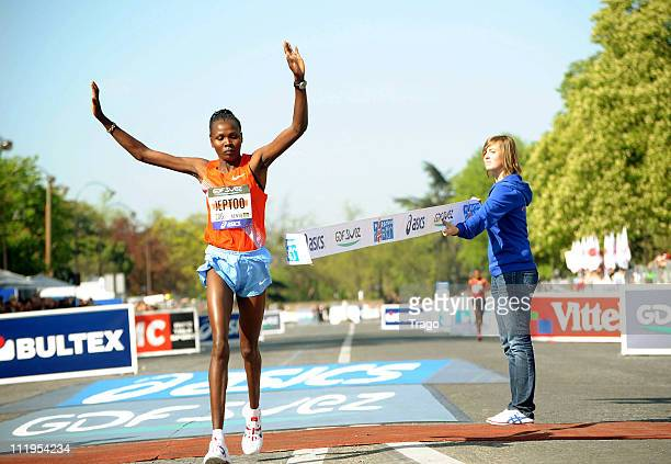 Jeptoo Priscah of Kenya crosses the finish line to win the 35th Paris Marathon on April 10 2011 in Paris France