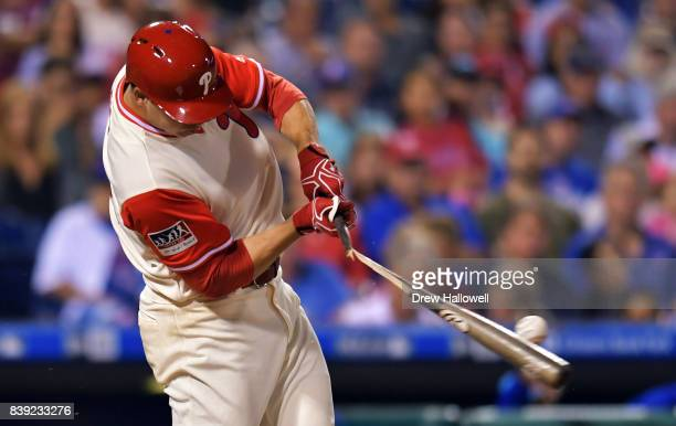 Jerad Eickhoff of the Philadelphia Phillies breaks his bat in the third inning against the Chicago Cubs at Citizens Bank Park on August 25 2017 in...