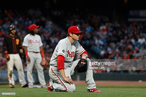 Jerad Eickhoff of the Philadelphia Phillies reacts after a bunt single by Ty Blach of the San Francisco Giants during the fourth inning at ATT Park...
