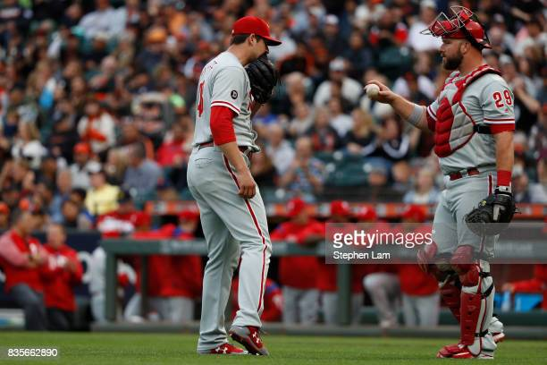 Jerad Eickhoff of the Philadelphia Phillies reacts after walking San Francisco Giants pitcher Ty Blach during the second inning against the San...