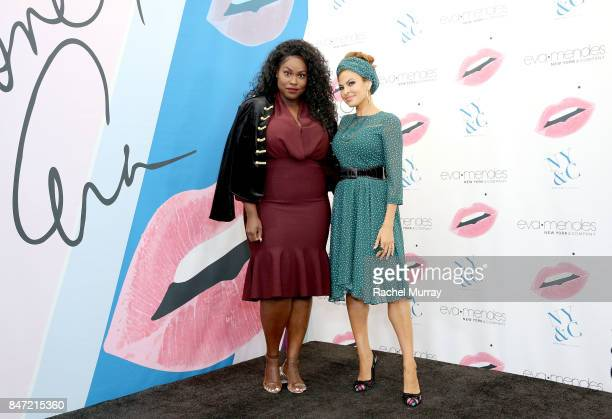 Jerae Campbell @curvyology poses with Eva Mendes during Eva Mendes's launch of her fall collection with new extended sizes at New York Company in Los...