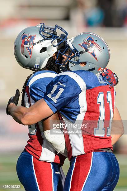 Jerald Brown of the Montreal Alouettes and teammate Chip Cox hug during the CFL game against the Saskatchewan Roughriders at Percival Molson Stadium...