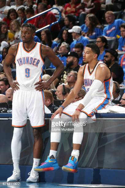 Jerami Grant and Andre Roberson of the Oklahoma City Thunder look on during the game against the Houston Rockets during the Western Conference...