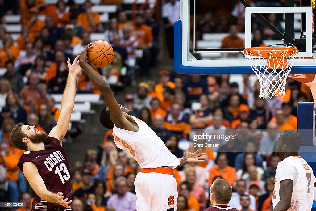 Jerami Grant #3 of Syracuse Orange pulls down a rebound in the second half of a basketball game as Murphy Burnatowski #13 of Colgate Raiders reaches from the left on November 16, 2013 at the Carrier Dome in Syracuse, New York. Syracuse defeated Colgate 69-50.
