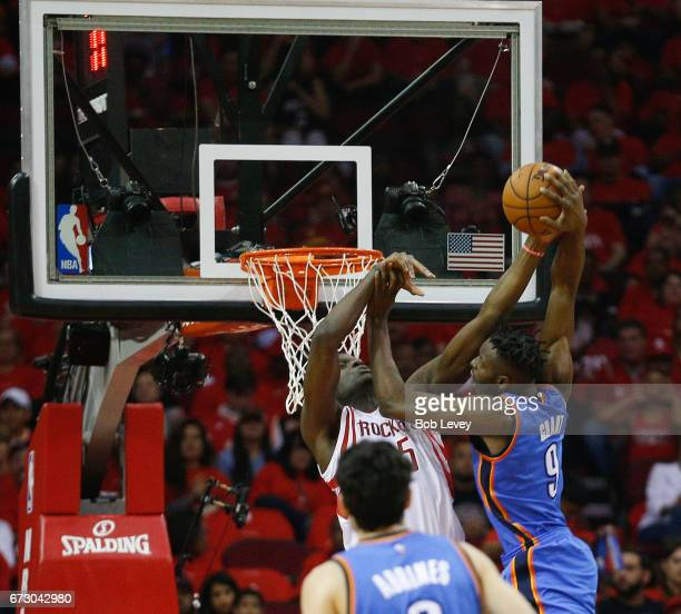 Jerami Grant of the Oklahoma City Thunder drives on Clint Capela of the Houston Rockets during Game Five of the Western Conference Quarterfinals game...