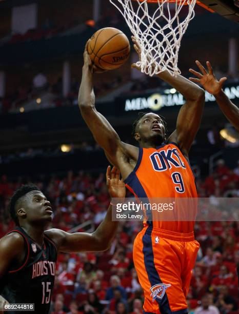 Jerami Grant of the Oklahoma City Thunder dunks on Clint Capela of the Houston Rockets during Game One of the first round of the Western Conference...