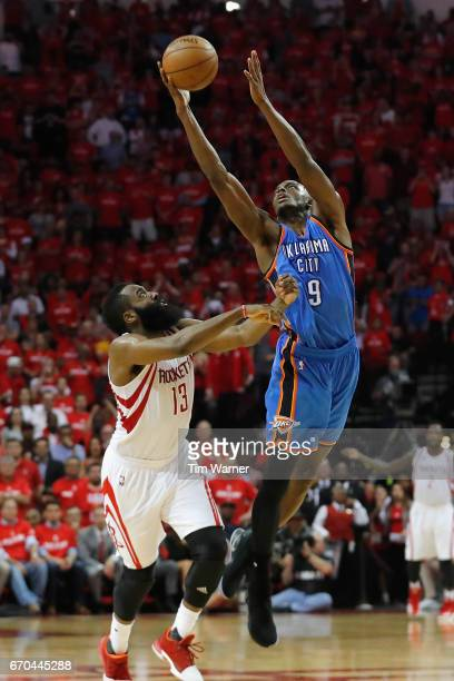 Jerami Grant of the Oklahoma City Thunder leaps for a pass defended by James Harden of the Houston Rockets in the second half of Game Two of the of...