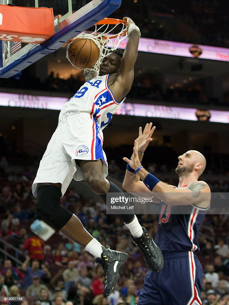 Jerami Grant #39 of the Philadelphia 76ers dunks the ball against Marcin Gortat #13 of the Washington Wizards in the first half of a preseason game at Wells Fargo Center on October 6, 2016 in Philadelphia, Pennsylvania.