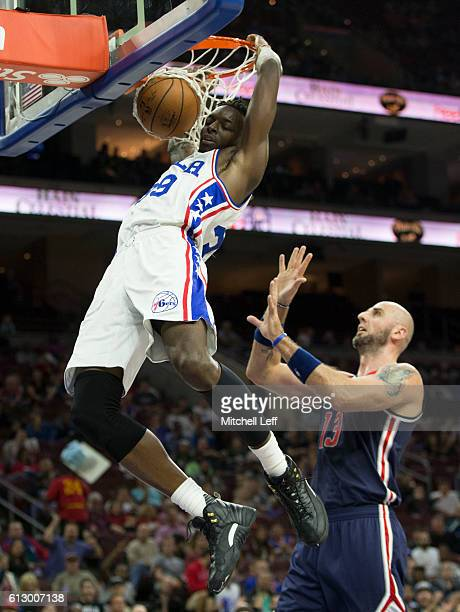Jerami Grant of the Philadelphia 76ers dunks the ball against Marcin Gortat of the Washington Wizards in the first half of a preseason game at Wells...