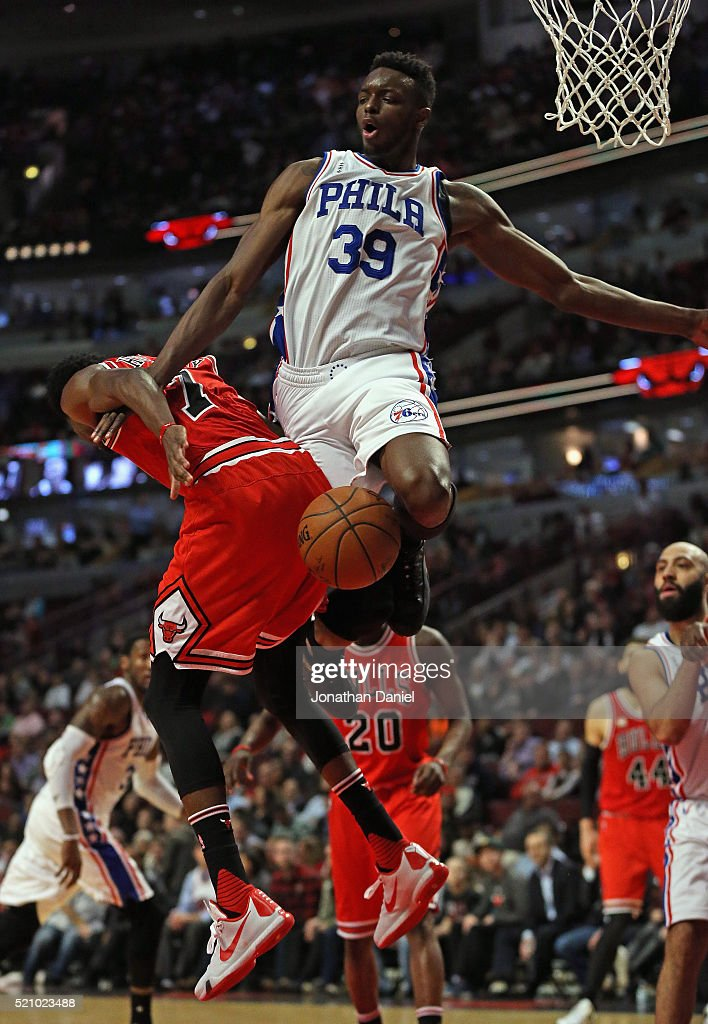 Jerami Grant #39 of the Philadelphia 76ers fouls Justin Holiday #7 of the Chicago Bulls at the United Center on April 13, 2016 in Chicago, Illinois. The Bulls defeated the 76ers 115-105.