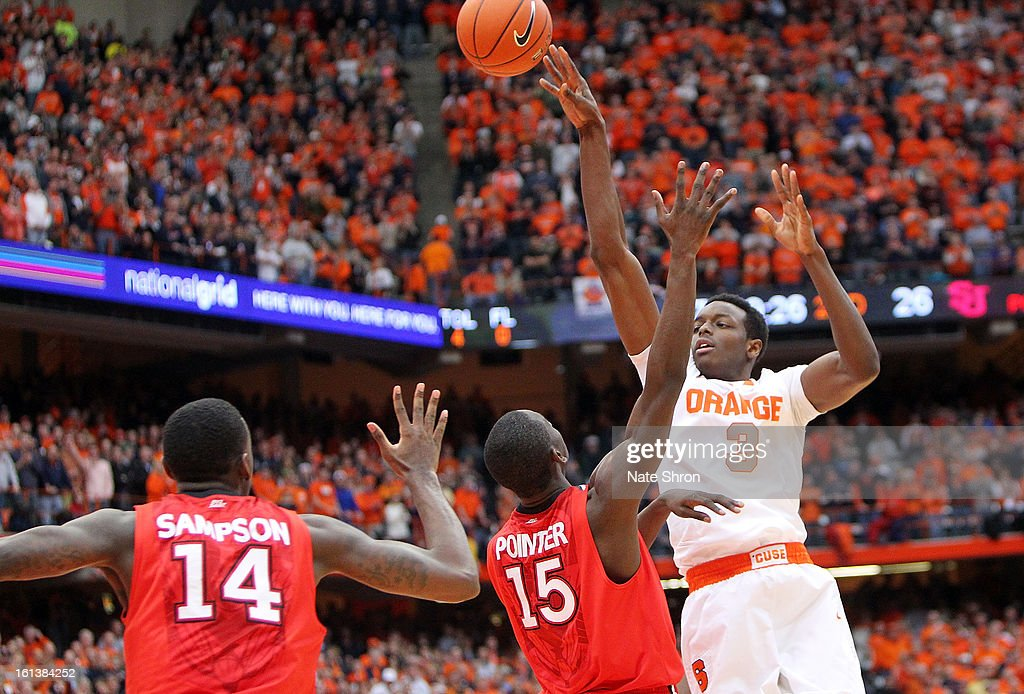 Jerami Grant #3 of the Syracuse Orange passes the ball over Sir'Dominic Pointer #15 and Jakarr Sampson #14 of the St. John's Red Storm during the game at the Carrier Dome on February 10, 2013 in Syracuse, New York.