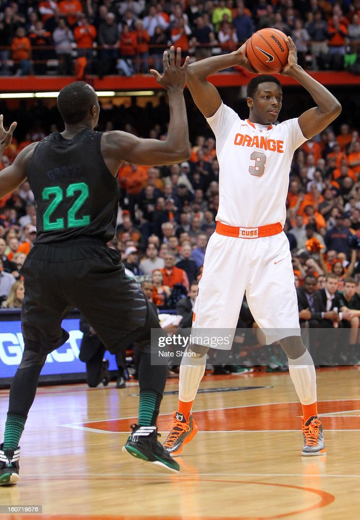 Jerami Grant #3 of the Syracuse Orange prepares to pass the ball against Jerian Grant #22 of the Notre Dame Fighting Irish during the game at the Carrier Dome on February 4, 2013 in Syracuse, New York.
