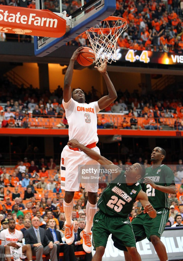 Jerami Grant #3 of the Syracuse Orange puts the ball up to the basket against Josh Thompson #25 of the Wagner Seahawks during the game at the Carrier Dome on November 18, 2012 in Syracuse, New York.