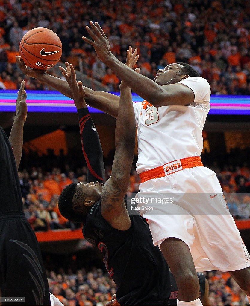 Jerami Grant #3 of the Syracuse Orange puts the ball up to the basket over Titus Rubles #2 of the Cincinnati Bearcats during the game at the Carrier Dome on January 21, 2013 in Syracuse, New York.