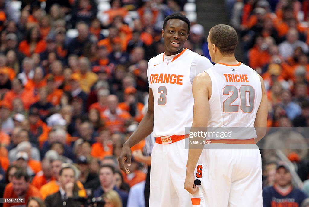 Jerami Grant #3 of the Syracuse Orange smiles as he talks with teamate <a gi-track='captionPersonalityLinkClicked' href=/galleries/search?phrase=Brandon+Triche&family=editorial&specificpeople=6516120 ng-click='$event.stopPropagation()'>Brandon Triche</a> #20 during a break in play against the Cincinnati Bearcats during the game at the Carrier Dome on January 21, 2013 in Syracuse, New York.