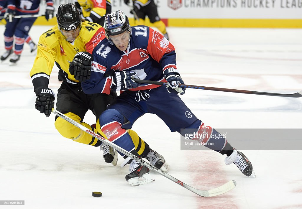 Jere Sneck of SaiPa Lappeenranta and Laurin Braun of the Eisbaeren Berlin during the game between the Eisbaeren Berlin and SaiPa Lappeenranta on...