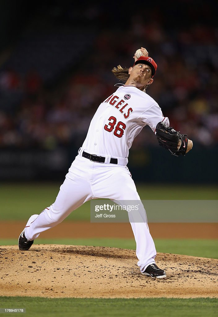 <a gi-track='captionPersonalityLinkClicked' href=/galleries/search?phrase=Jered+Weaver&family=editorial&specificpeople=565100 ng-click='$event.stopPropagation()'>Jered Weaver</a> #36 of the Los Angeles Angels of Anaheim pitches against the Cleveland Indians in the fourth inning at Angel Stadium of Anaheim on August 19, 2013 in Anaheim, California.