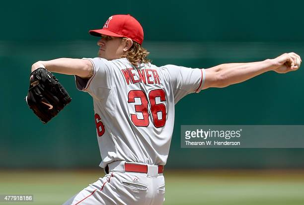 Jered Weaver of the Los Angeles Angels of Anaheim pitches against the Oakland Athletics in the bottom of the first inning at Oco Coliseum on June 20...