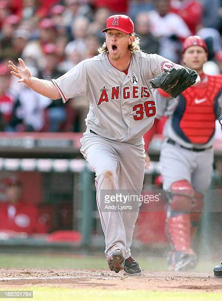 Jered Weaver of the Los Angeles Angels of Anaheim reacts after ShinSoo Choo of the Cincinnati Reds was called safe at hompe plate at Great American...