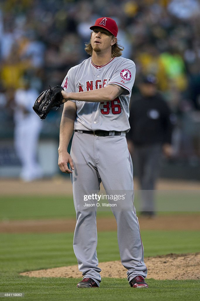 <a gi-track='captionPersonalityLinkClicked' href=/galleries/search?phrase=Jered+Weaver&family=editorial&specificpeople=565100 ng-click='$event.stopPropagation()'>Jered Weaver</a> #36 of the Los Angeles Angels of Anaheim reacts after giving up a home run to Andy Parrino (not pictured) of the Oakland Athletics during the seventh inning at O.co Coliseum on August 24, 2014 in Oakland, California.