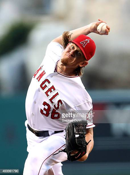 Jered Weaver of the Los Angeles Angels of Anaheim throws a pitch against the Boston Red Sox at Angel Stadium of Anaheim on August 8 2014 in Anaheim...