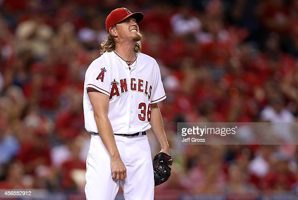 Jered Weaver of the Los Angeles Angels reacts after walking Mike Moustakas of the Kansas City Royals in the third inning during Game One of the...
