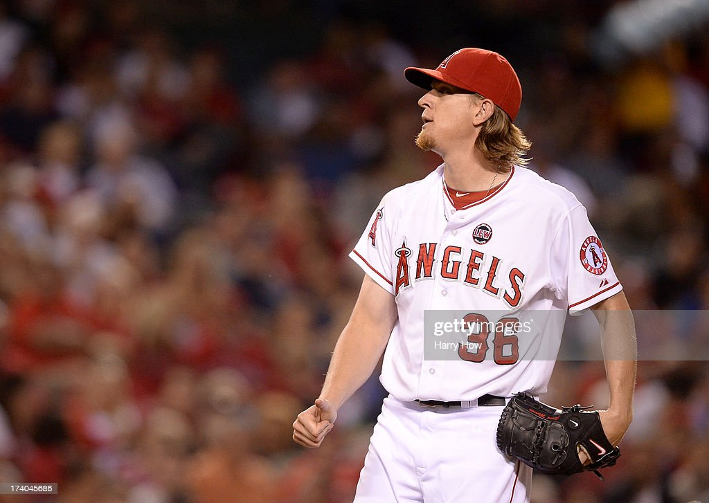 Jered Weaver #36 of the Los Angeles Angels reacts to the strikeout of Chris Young #25 of the Oakland Athletics during the seventh inning at Angel Stadium of Anaheim on July 19, 2013 in Anaheim, California.