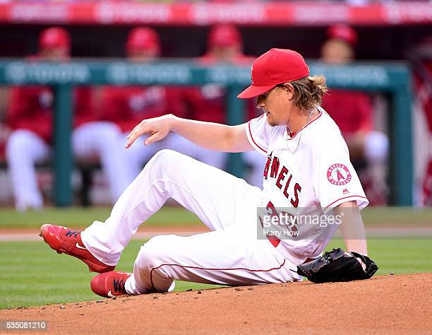 Jered Weaver of the Los Angeles Angels slips on the mound after his pitch during the first inning against the Houston Astros at Angel Stadium of...