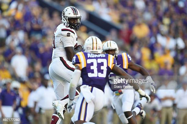 Jerell Adams of the South Carolina Gamecocks catches a pass for a touchdown between Jamal Adams and Kendell Beckwith of the LSU Tigers during the...