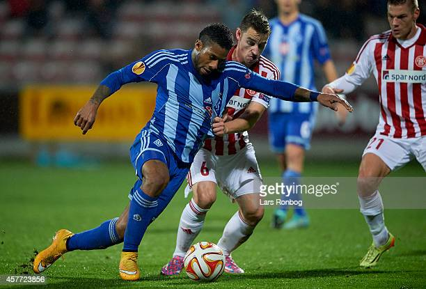 Jeremain Lens of Dynamo Kyiv and Donny Gorter of AaB Aalborg compete for the ball during the UEFA Europa League match between AaB Aalborg and Dynamo...