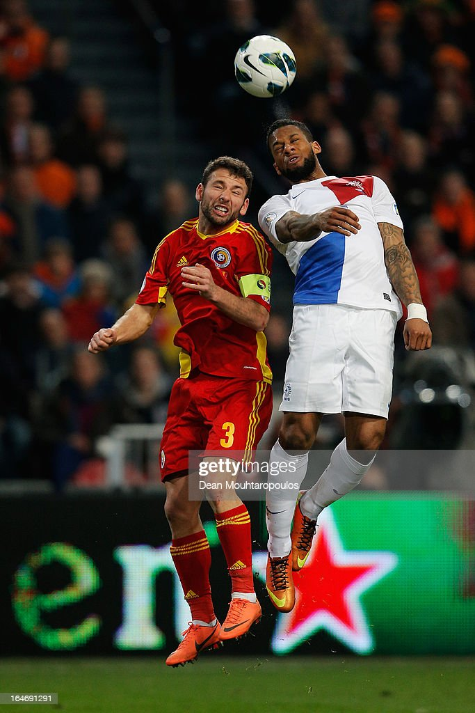 <a gi-track='captionPersonalityLinkClicked' href=/galleries/search?phrase=Jeremain+Lens&family=editorial&specificpeople=4174305 ng-click='$event.stopPropagation()'>Jeremain Lens</a> of Netherlands and Razvan Dinca Rat of Romania battle for the header during the the Group 4 FIFA 2014 World Cup Qualifier match between Netherlands and Romania at Amsterdam Arena on March 26, 2013 in Amsterdam, Netherlands.