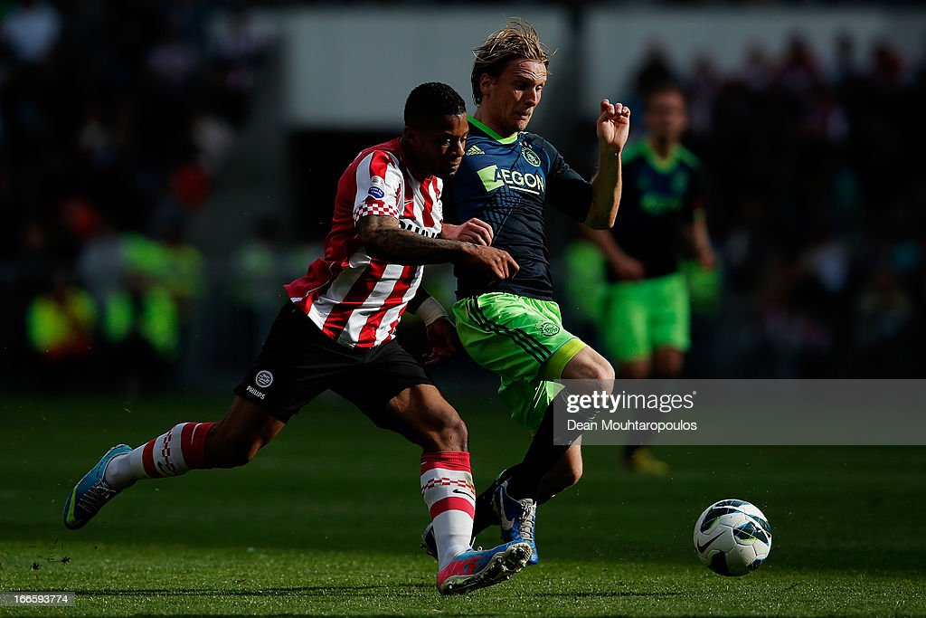 <a gi-track='captionPersonalityLinkClicked' href=/galleries/search?phrase=Jeremain+Lens&family=editorial&specificpeople=4174305 ng-click='$event.stopPropagation()'>Jeremain Lens</a> of PSV and Christian Poulsen of Ajax battle for the ball during the Eredivisie match between PSV Eindhoven and Ajax Amsterdam at Philips Stadion on April 14, 2013 in Eindhoven, Netherlands.