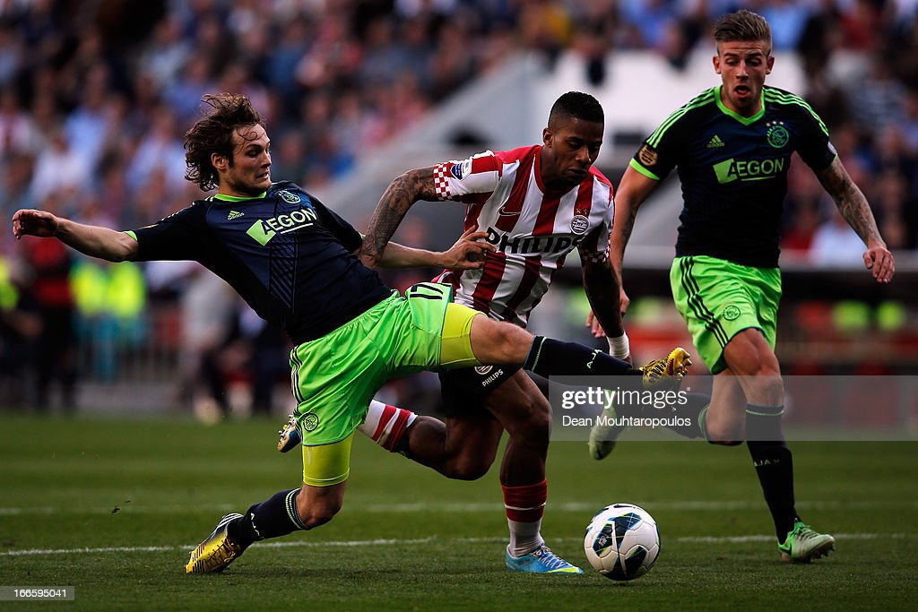 <a gi-track='captionPersonalityLinkClicked' href=/galleries/search?phrase=Jeremain+Lens&family=editorial&specificpeople=4174305 ng-click='$event.stopPropagation()'>Jeremain Lens</a> of PSV and Daley Blind of Ajax battle for the ball during the Eredivisie match between PSV Eindhoven and Ajax Amsterdam at Philips Stadion on April 14, 2013 in Eindhoven, Netherlands.