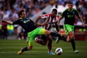 Jeremain Lens of PSV and Daley Blind of Ajax battle for the ball during the Eredivisie match between PSV Eindhoven and Ajax Amsterdam at Philips...