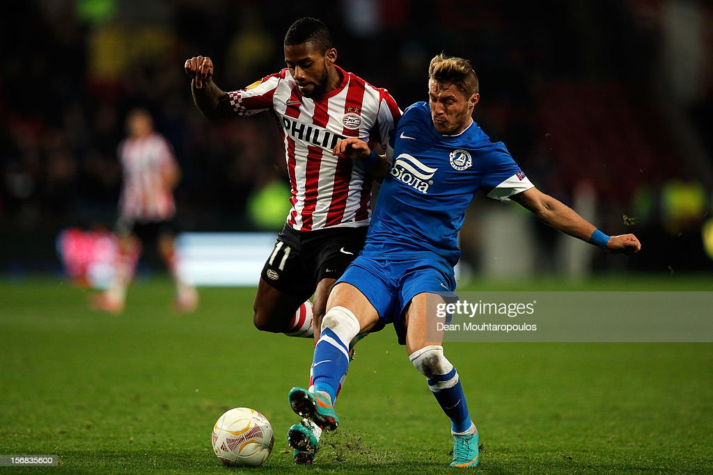Jeremain Lens of PSV and Vitaliy Mandziuk of Dnipro battle for the ball during the UEFA Europa League Group F match between PSV Eindhoven and FC Dnipro Dnipropetrovsk at the Philips Stadion n November 22, 2012 in Eindhoven, Netherlands.