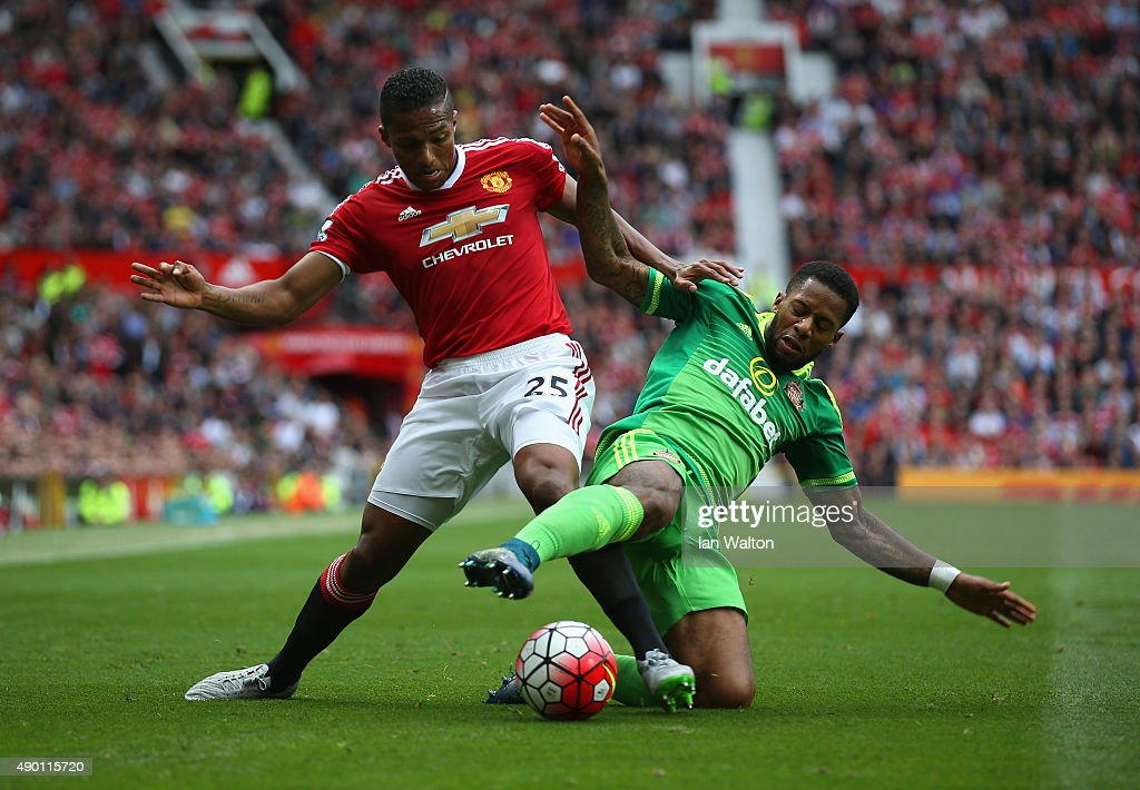 Jeremain Lens of Sunderland and Antonio Valencia of Manchester United compete for the ball during the Barclays Premier League match between Manchester United and Sunderland at Old Trafford on September 26, 2015 in Manchester, United Kingdom.